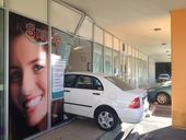 A WHITE sedan has crashed into the front of Smile By Design dentist on Wises Rd, Maroochydore.