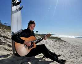 He almost died, now surfer, muso Jock is living the dream