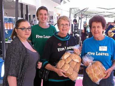GOOD FOOD: Five Loaves volunteers handing out fresh bread and salad at Southern Cross University.