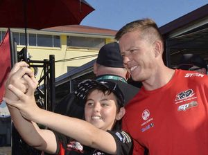 FUN FOR FANS: Brandon Scerri, 12, gets a photo with driver James Courtney.