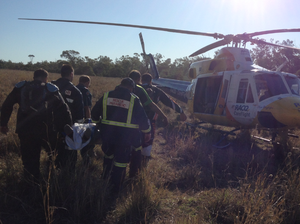 The patient was stretchered to a waiting helicopter.