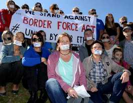 Workers rally to protest gagging of detention centre staff