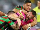 PREMIER South Sydney narrowly escaped becoming another major shock loser in a round of NRL upsets against a plucky Penrith.