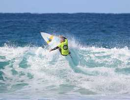 Phillips battles grief to claim surf festival title