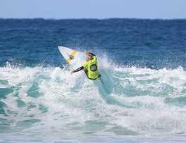 Phillips battles grief to claim surf festival title