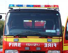Emergency service crews at large grass fire at Beecher