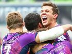 SWEET: Matt Duffie of the Melbourne Storm is congratulated by his teammates after scoring a try at AAMI Park yesterday.