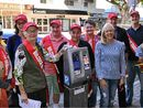 CALOUNDRA business owners have donned sashes and taken to the streets to top up the only parking meters in the entire region.