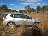The woman's car left the road after trying to overtake a truck and caravan on a long, straight stretch of road.