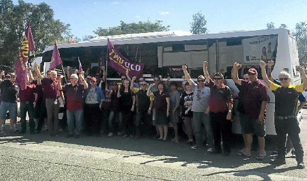 ALL ABOARD: TWU activists about to get on the bus taking them on a protest trip down the coast this week. The activists protested outside Coles.