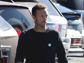 """CHRIS Martin is still """"crazy"""" about Jennifer Lawrence and """"doesn't really want their relationship to end."""""""