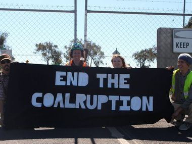 The mine has caused friction on the Darling Downs. Jamie Yarnold, Kelly Purnell, Chantelle McKenna and Dylan Sweeney protest outside the Acland mine gate in August this year.