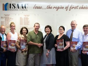 Author Tony Price (green shirt) presenting copies of his book A History of Mackay Rugby League to Isaac Region Council - Cr Jane Pickels, Cr Nick Wheeler, Cr Kelly Vea Vea, Cr Barbara Stranks, Mayor Anne Baker, Cr Gina Lacey, Cr Geoff Bethel, Cr Peter Freeleagus and Deputy Mayor Cr Dale Appleton to distribute to their local libraries and high schools.