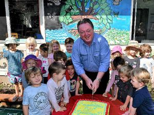 KINDY CAKE: Member for Noosa Glen Elmes presents a donation and cake to the kindy on the occasion of their 50th anniversary.