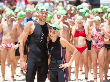 Noosa-based world 70.3 champion Jan Frodeno and wife Emma Snowsill at the annual Noosa Summer Swim.