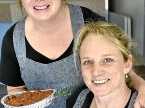 MAKING LIFE EASIER: Lisa Matthews (left) and Megan Neilson spend three days a week cooking meals for busy Toowoomba families.