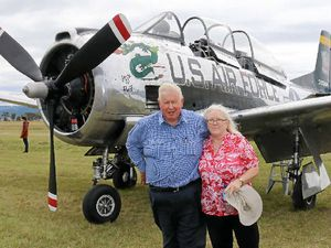 READY TO TAKE OFF?: Kim Rolph-Smith and Louise Bailey with the T28 warbird at the Gathering of Eagles fly-in at Watts Bridge Memorial Airfield.
