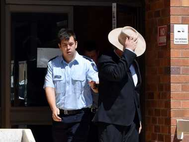 TEEN JAILED: Emerald police lead Dylan Elliot Burke from the Emerald District Court yesterday after he was sentenced to serve three months jail.