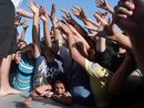 AUSTRALIA will take in an extra 12,000 Syrian refugees on a one-off basis over and above the current intake of 13,750, the Abbott government announced today.