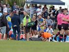 Murwillumbah player Nick Crompton receives attention waiting for the ambulance to arrive after he was injured during the NRRRL grand final.