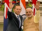 ONE YEAR AGO: Prime Minister Tony Abbott and India's Narendra Modi agree on a deal to sell uranium to India for power generation.