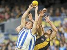 THE Tigers suffered their third-straight elimination defeat yesterday, this time at the hands of North Melbourne in front of a packed MCG.
