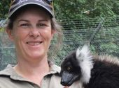 THE zoo keeper who was fatally attacked by a tiger at Hamilton Zoo yesterday was a mother of two who loved her family, colleagues and job.