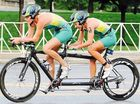 CASINO-born triathlete Katie Kelly has managed to swim, cycle and run her way to the top of the para world championship podium, despite being legally blind.