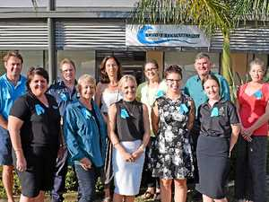 TEAL TROOP: (Back) Damien Plackett (Department of Communities and Disability Services), Sgt Simon Walter (Whitsunday Police), Isa Steinhauer, Jan Waetford, Steve Alexander, Sandra Kelly and (front) Cathy Thomson (WCCS), Cr Jan Clifford, Alanna Schneider and Heather Carr (WCCS) and Cassie Holeczy (PCYC).