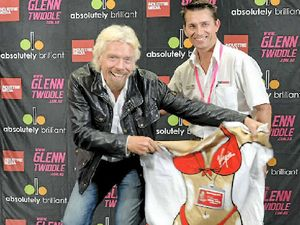 STAR STRUCK: Local real estate agent Brad Sobott (right) rubs shoulders with Richard Branson late last month. Photo: Dean Summers