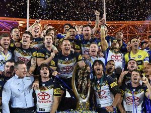 Cowboys players celebrate victory in the NRL Grand Final between the Brisbane Broncos and the North Queensland Cowboys  (AAP Image/Dean Lewins)