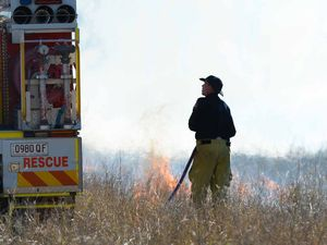 IN ACTION: Firefighters tackle a grassfire burning on a property on River Rd, Port Curtis on Saturday afternoon.