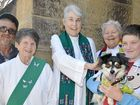 Pets and their owners line up for a blessing at St Mark's