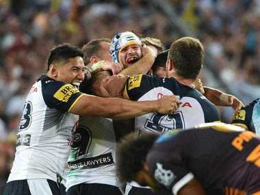 Cowboys co-captain Johnathan Thurston (centre) celebrates with team mates after winning the NRL Grand Fin