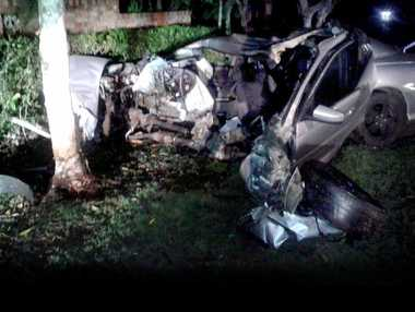 RUNAWAY DRIVER: The remains of a car that hit a tree on Ballina Rd on Saturday night. The driver fled the scene.
