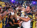 AFL and NRL premiership winners share the moment with their children