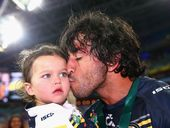 The everlasting images from both AFL and NRL premiership-deciders will be of victorious players embracing their children.