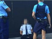 POLICE in Sydney have arrested a student on his way to the same school attended by the 15-year-old who shot a man dead at Parramatta's police headquarters.