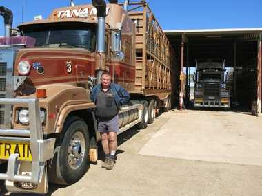 Tanami Transport Operations Manager Mark Castagna with one of their fleet that regularly tackle rough outback highways. Photo Felicty Forth / Big Rigs