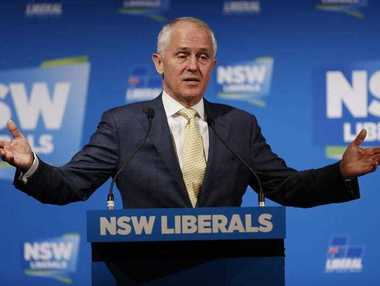 Australia Prime Minister Malcolm Turnbull gestures as he speaks Saturday, Oct. 10, 2015. Mr Turnbull was addressing delegates during the NSW liberal Party State Council in Sydney, Australia.