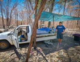 Sleeping on ute tray after fire destroys his cottage home