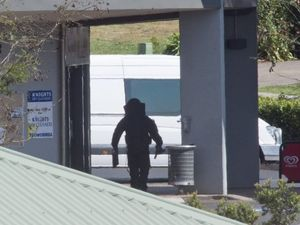 A member of Explosive Ordnance Response Team (bomb squad) at the shopping centre at the centre of an incident in Hogg St, Wilsonton Heights which caused police to declare an emergent situation under the provisions of the Public Safety Preservation Act after a suspicious device was found.