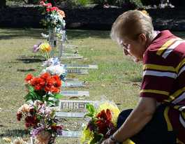 Mum heartbroken as flowers taken from babies' graves