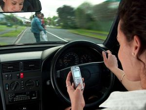 DISTRACTION: Using your mobile phone while driving can bring costly consequences. Photo: contributed