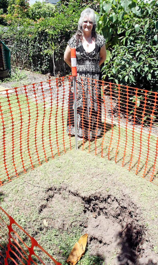 Small sinkhole opens up in Bribie backyard   Sunshine ...