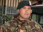 A KIWI war hero held at a high-security prison in Australia despite not committing a crime once acted as John Key's personal bodyguard, his partner claims.