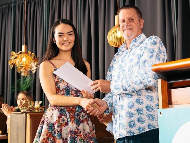 TAFE Queensland East Coast General Manager Paul Wilson presents Lakkari Kim with formal acknowledgement of her three month internship win. Photo: Brian Geritz Photography.