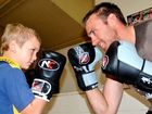 SON V DAD: Nate Glasby (left) has been getting lessons from dad Simon Glasby at Tuesday night boxing at Maranoa PCYC.