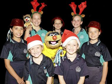 SING PROUD: Jamie Dunn and Agro attend Bribie Island State School to judge them as finalists in the Morayfield Shopping Centre Christmas carols competition.