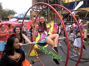 Aleshanee Kelso from the Spaghetti Circus enjoys the ride during the Festival Parade Photo Ross Kendall / Northern Star